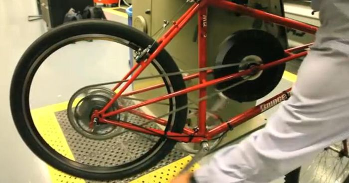 Flywheel powered bicycle