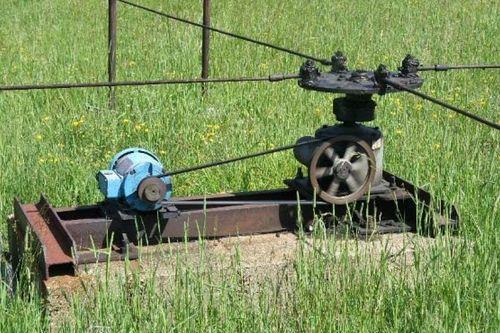 Field motor on steel frame with steel jerker rods on the james field