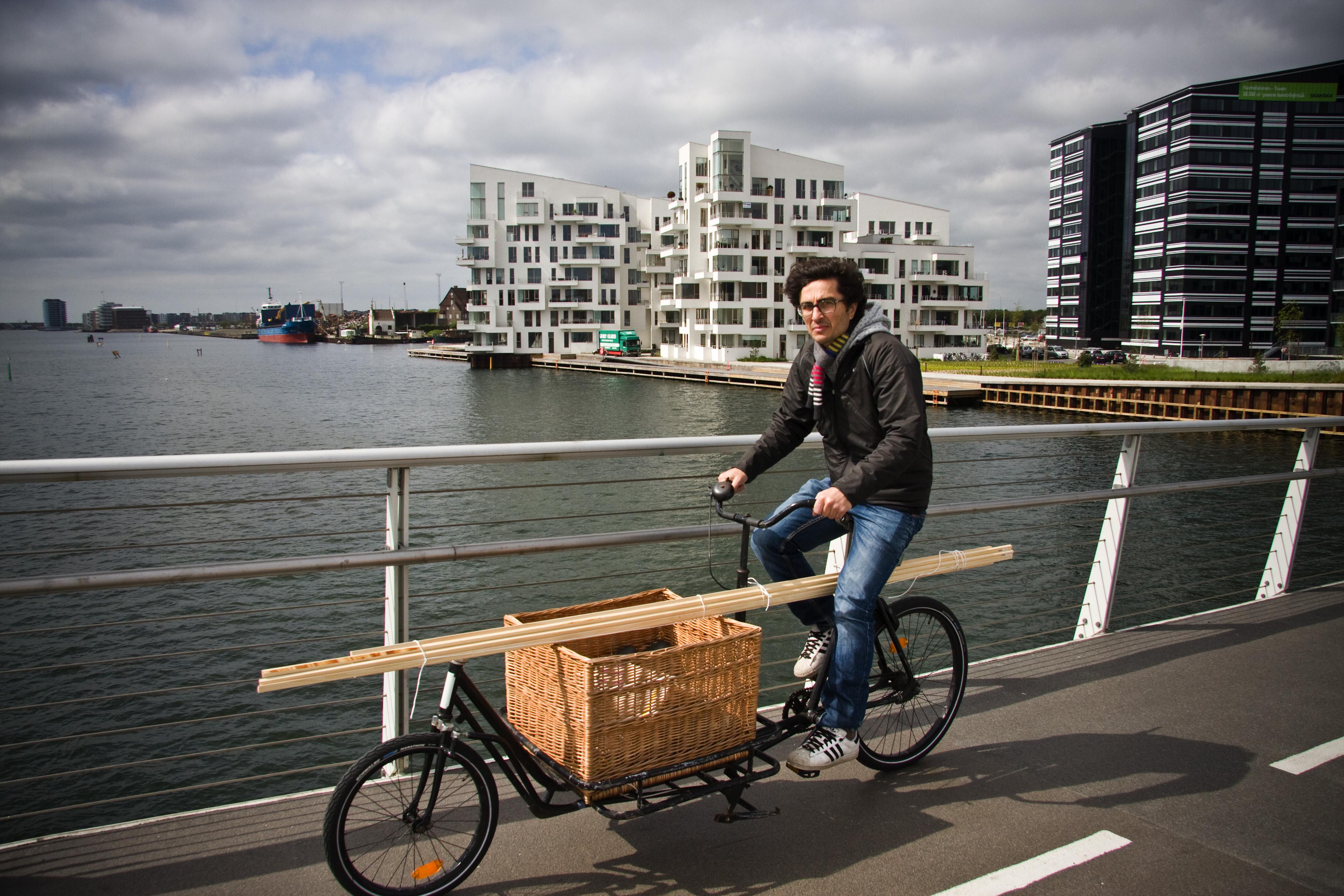 Carpenter riding a cargo cycle in copenhagen