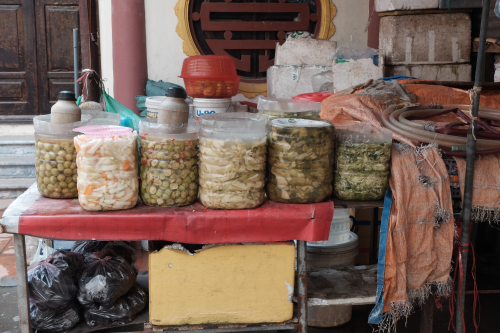 A stall selling homemade dưa chua in a Hanoi market