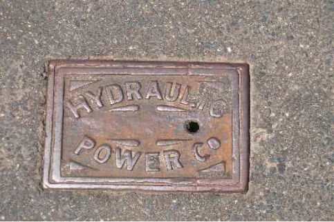 Hydraulic power company valve cover