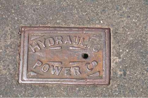 Hydraulic power company valve cover