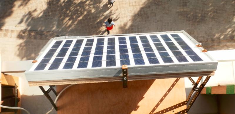 Solar panel on apartment window sill