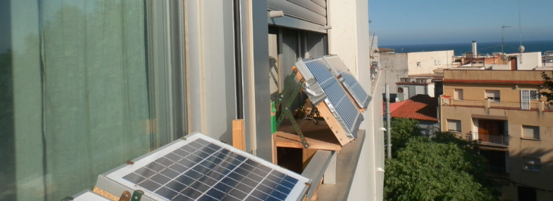 off-the-grid apartment solar panels on window sills