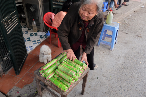 Woman sells nem chua raw fermented pork outside her house