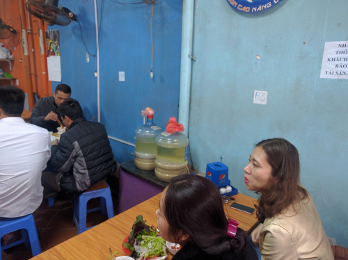A restaurant offers homebrewed rượu men Vietnamese rice wine